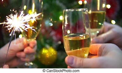 Glasses of champagne on the background of the Christmas tree