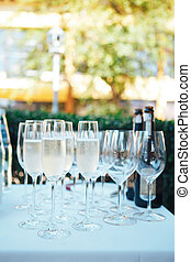 Glasses of champagne on the festive table. Glasses of champagne outdoors