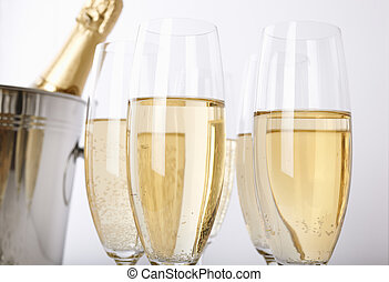 Glasses of champagne - selective focus on nearest part of...