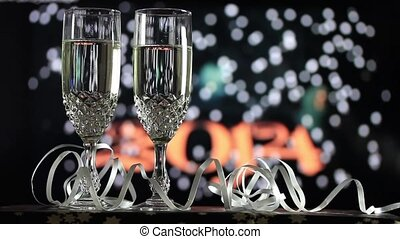 Glasses of champagne on fireworks background