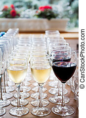 Glasses of champagne white wine, red wine. Glass glasses with colored drinks on the table