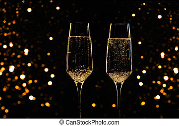 Glasses of champagne with black background