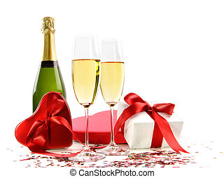 Glasses of champagne with bottle and gifts