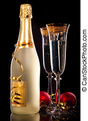 Glasses of champagne with bottle