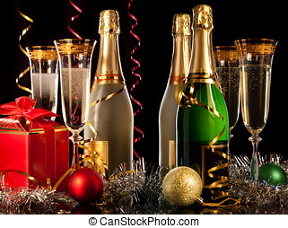 Glasses of champagne with bottles and christmas balls