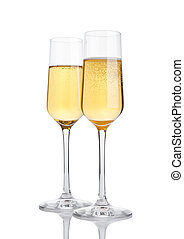 Glasses of champagne with bubbles on white