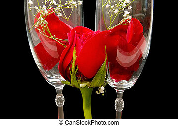 glasses of champagne with petals