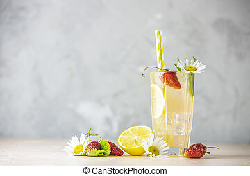 Glasses of cold icy refreshing drink with lemon and ...