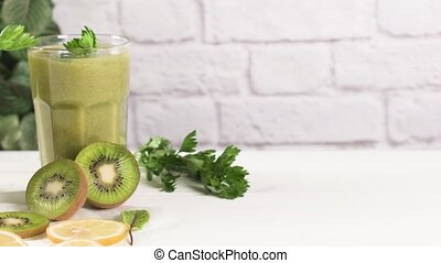 Green vegetable smoothie - Glasses of green vegetable...