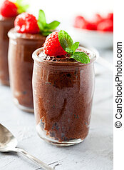 Glasses Of Homemade Chocolate Mousse With Raspberries