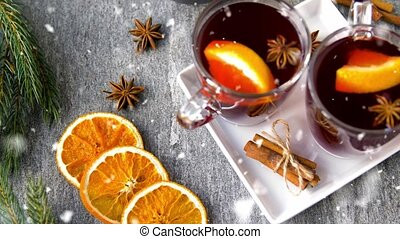 glasses of hot mulled wine with orange and spices - ...