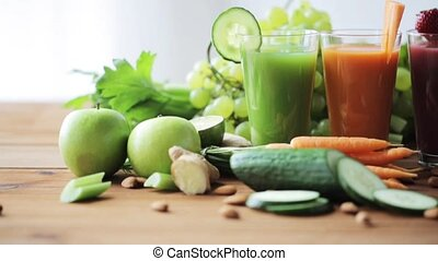 glasses of juice, vegetables and fruits on table