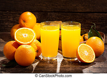 glasses of orange juice with fresh fruits