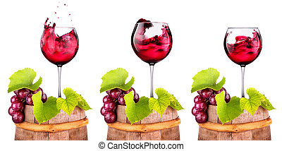 Glasses of red wine on a wooden barrel with grape