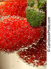 Glasses of sparkling wine and strawberry, macro