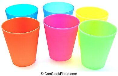 Glasses of various colors on each other surrounded by white...