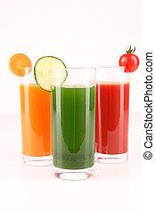 glasses of vegetables juice on white