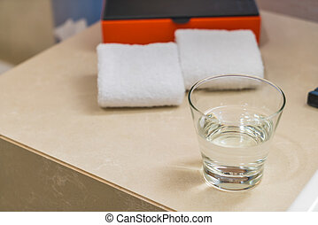 Glasses of water on table .