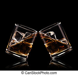 Glasses of whiskey on black background
