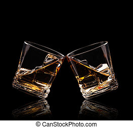 Glasses of whiskey on black background