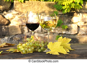 Glasses of wine and a bunch of grapes. Lavaux region, Switzerland