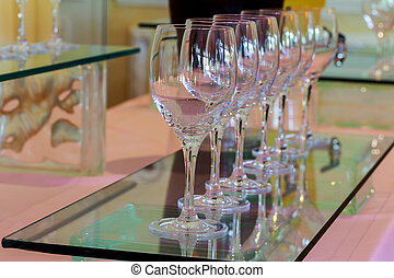 glasses of wine at the bar Many glasses of different wine in a row on bar counter