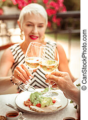 Close up of wife and husband drinking white wine in the evening