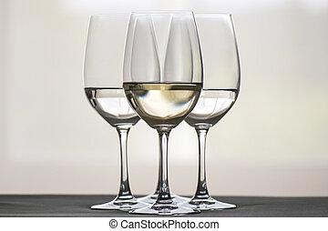 glasses of wine - Four glasses of white wine, arranged...