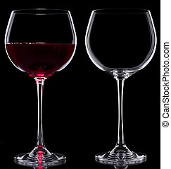Glasses of wine - Two Glasses red wine and empty over black...