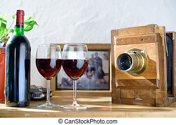 glasses of wine with an old camera