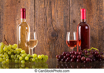 Glasses of wine with bottles and grapes