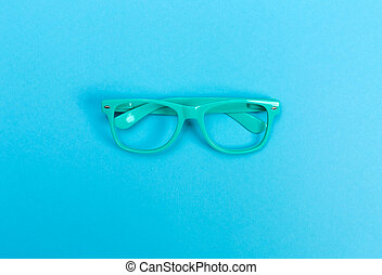 Glasses on a bright blue background