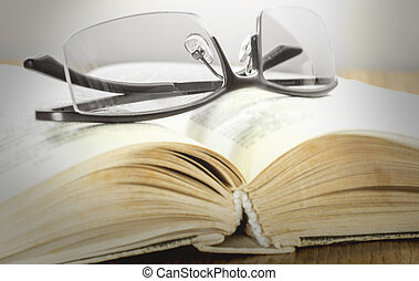glasses on a gross book