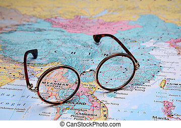 Glasses on a map of Asia - Myanmar
