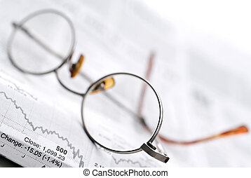 Glasses on a newspaper stock report