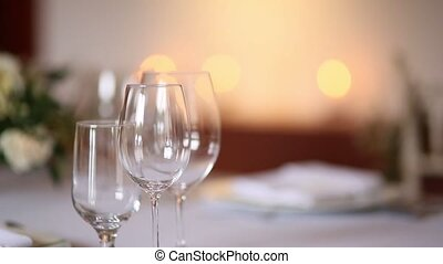 Glasses on a table at a restaurant. The restaurant's interior