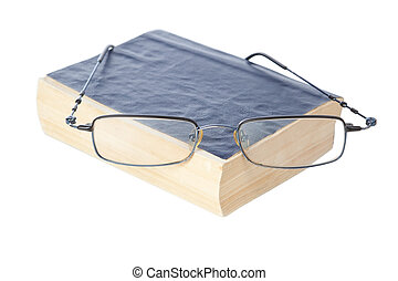 Glasses on the ancient book. On a white background.