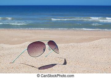 Glasses on the beach. Seascape.