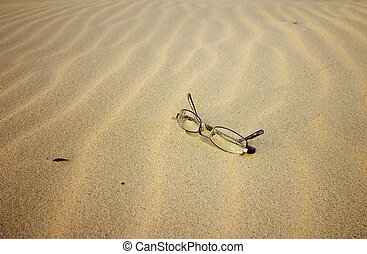 Glasses on the beach