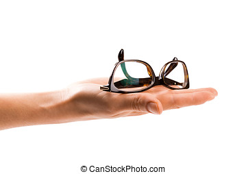 glasses on womans hand isolated on white background