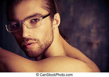 glasses - Sexual muscular nude man posing over dark...