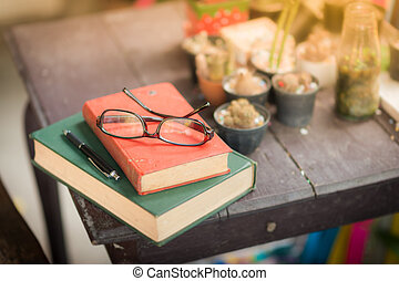 Glasses put down on table - Glasses with books and pen on...