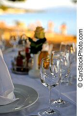 empty vine glasses at outdoor restaurant