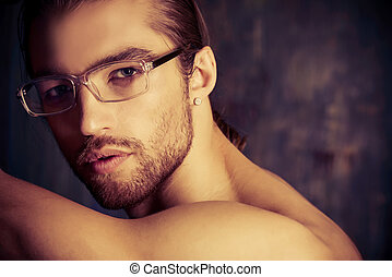 glasses - Sexual muscular nude man posing over dark ...