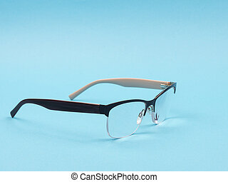 Glasses to improve vision on a blue background.