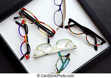 Glasses - Various colorful and stylish glasses on a tray