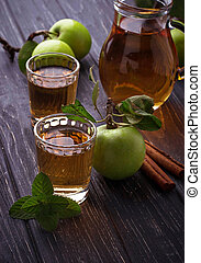 Glasses with apple juice on wooden table
