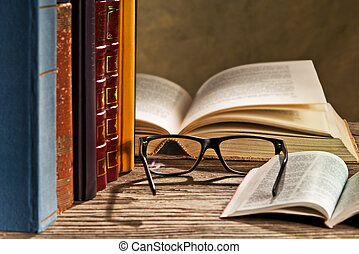 glasses with books