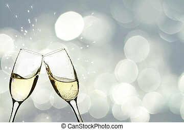 Glasses with champagne against holiday lights - Glasses with...