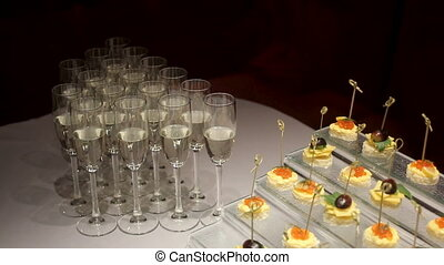 glasses with champagne and snacks